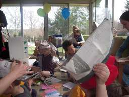 Making origami hats from newspapers.