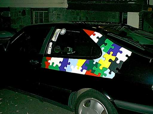 The Puzzle Car, with additional pieces.